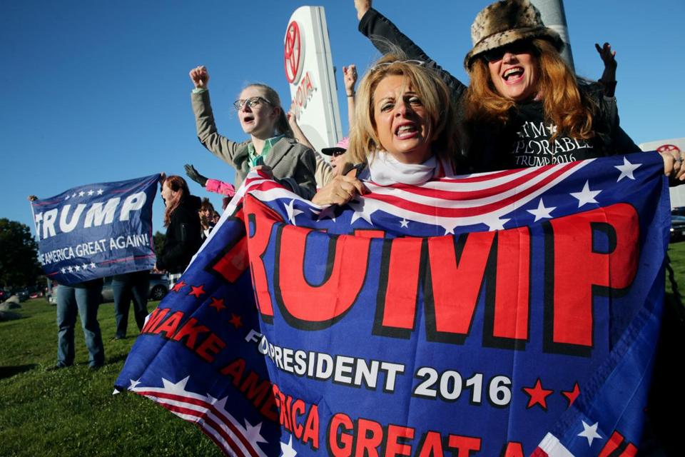 10/15/2016 - Portsmouth, NH - October 15, 2016: A group of women show their support for Donald Trump before a Donald Trump Rally at Toyota of Portsmouth in Portsmouth, NH on October 15, 2016. (Craig F. Walker/The Boston Globe)