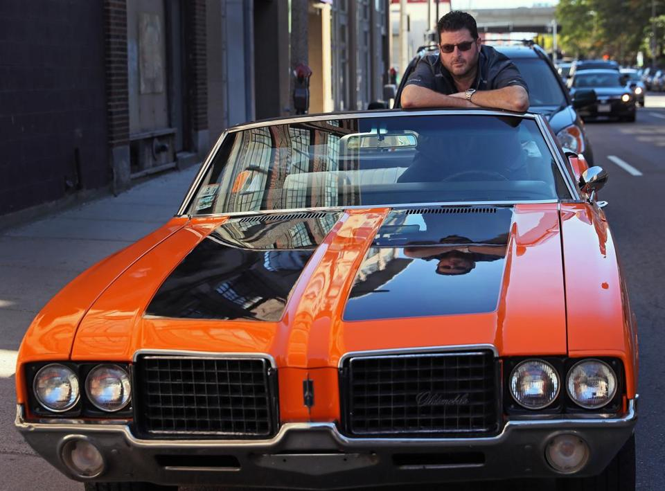 Evan Deluty, the owner/chef of Stella, with his vintage 1972 Oldsmobile Cutlass Supreme convertible.