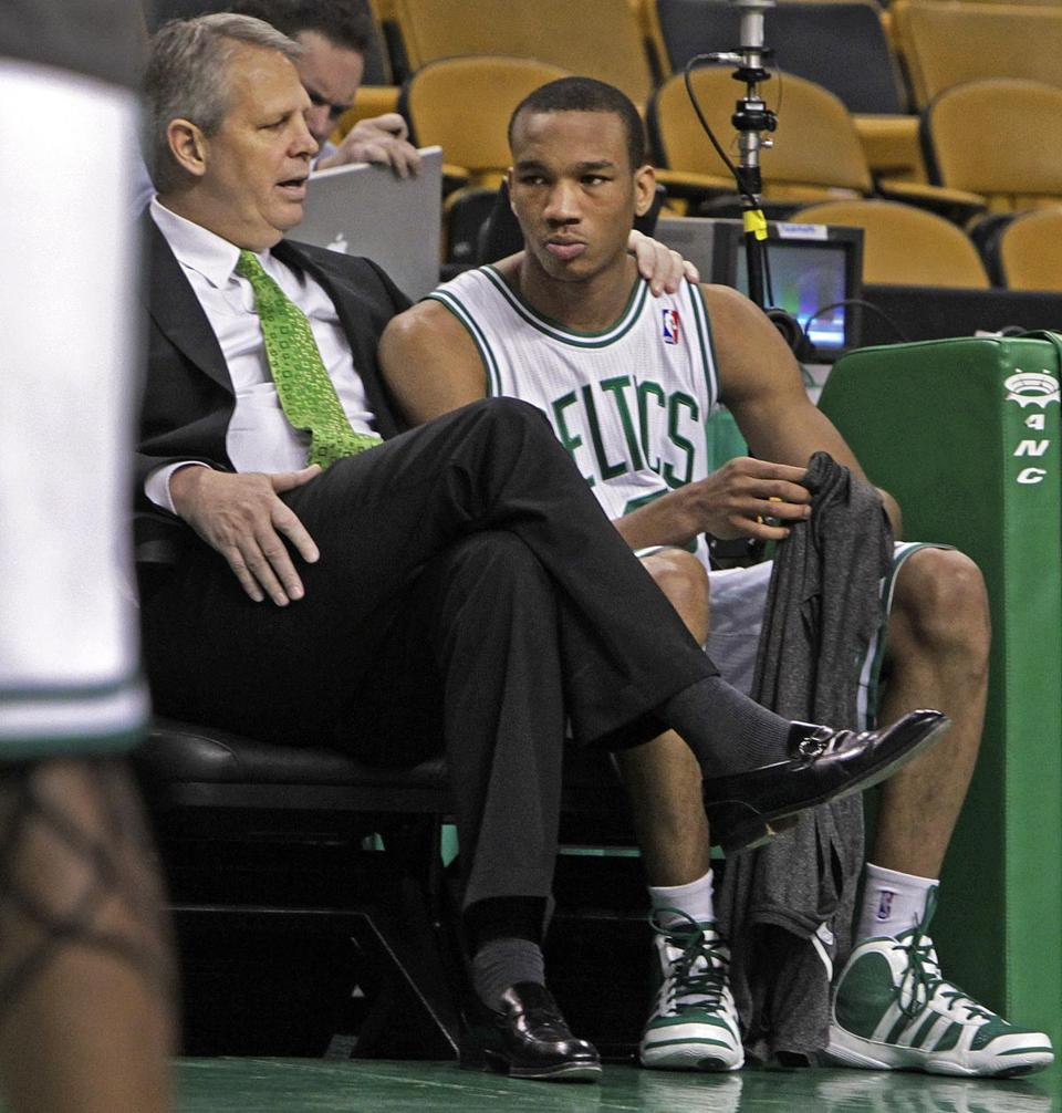 4-3-11 Boston, MA: Celtics head man Danny Ainge puts his arm on the shoulder of rookie Avery Bradley as he chats with him just after the shooting of the team photo this afternoon. With Shaquille O'Neal activated for the game, perhaps it is Bradley who is the odd man out for tonight's game. The Celtics host the Detroit Pistons in an NBA regular eason game at the TD Garden. (Globe Staff Photo/Jim Davis) Section:Sports Slug:Unknown