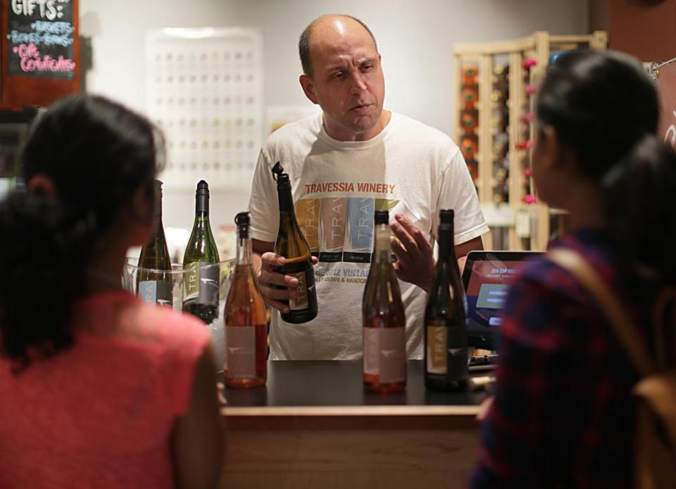Marco Montez of Travessia Urban Winery offers samples of his wine at the Massachusetts Wine Shop.