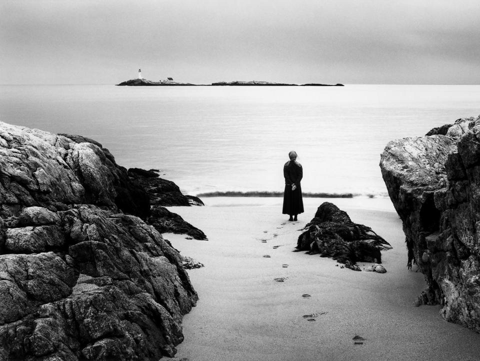 Photographer Alexandra de Steiguer's self-portrait on Star Island, off the New Hampshire coast, looking toward the White Island Lighthouse.