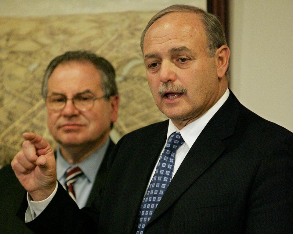 Massachusetts Speaker of the House Sal DiMasi, right, faces reporters as House Ways and Means Committee Chairman Robert DeLeo, D-Winthrop, left, looks on during the unveiling of a Democratic state budget proposal at the Statehouse in Boston, Monday, April 10, 2006. House Democratic lawmakers presented the $25.27 billion budget proposal Monday that represents a 5.7 percent increase over current spending and sets aside $200 million for a new health care plan. (AP Photo/Steven Senne) Library Tag 06232006 Metro