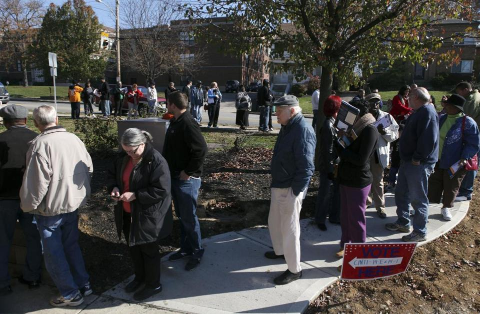 People wait outside to cast their ballots at the Pleasant Ridge Community Center in Cincinnati during the 2012 presidential election.