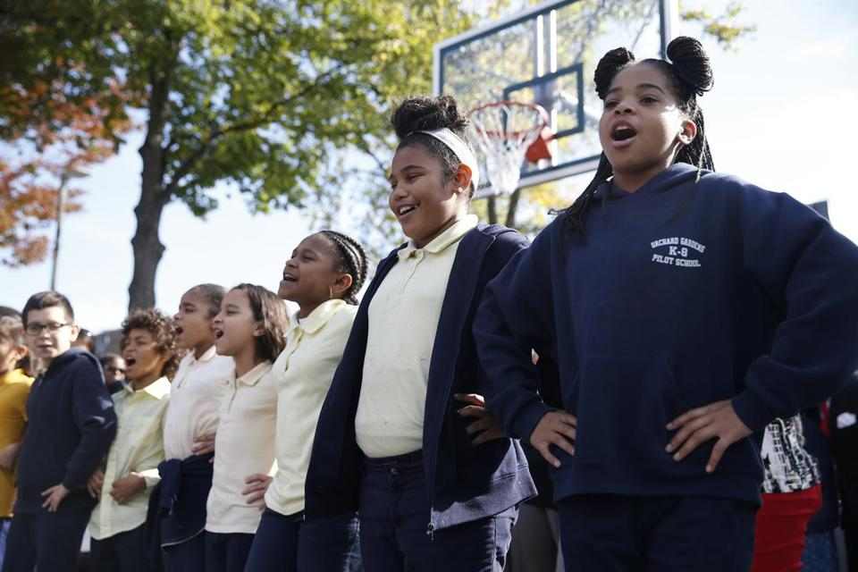 Boston, MA--10/20/2016-- Students from the Orchard Gardens K-8 School perform during a dedication of Michael L. Bivins Court at Ramsay Park in Boston, MA, October 19, 2016. (Jessica Rinaldi/Globe Staff) (Jessica Rinaldi) Topic: 21dedicationpic Reporter: