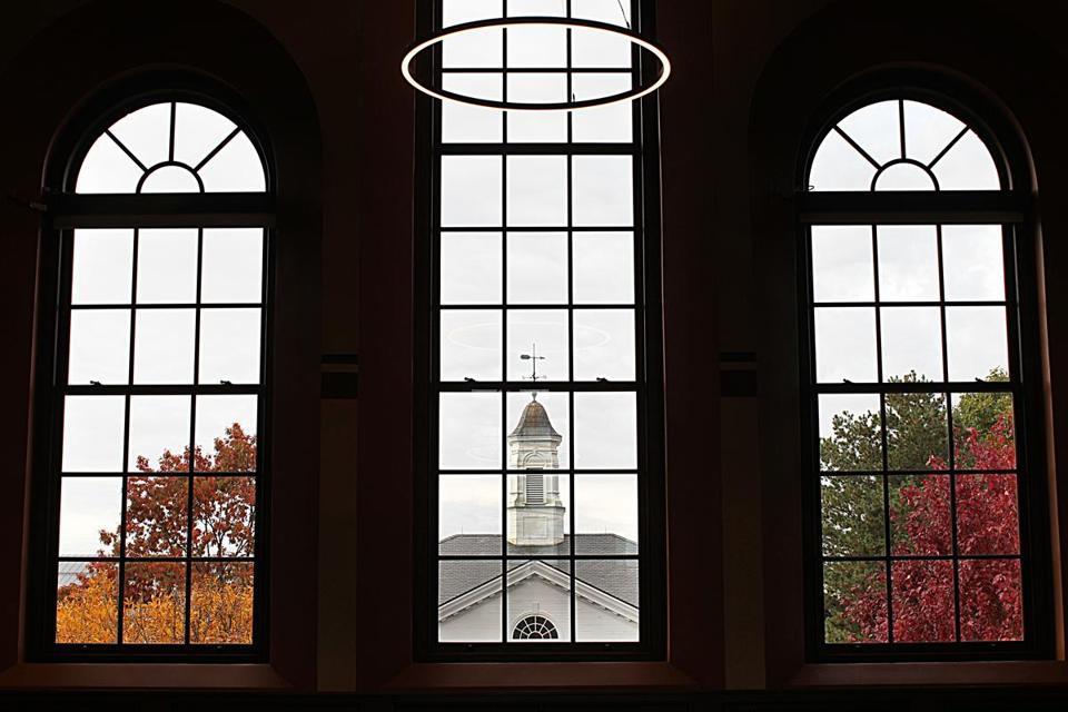 From within the second-floor Great Hall of the Old Chapel, a New England fall pallette is framed through the grand windows.