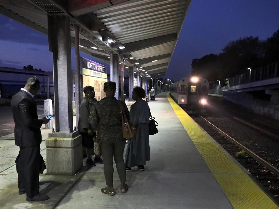 BOSTON, MA - 10/19/2016: The train arrives at 865 Morton St Mattapan train stop, rders of train 750 are used to the shortcomings of Keolis Commuter Services. Last week, their 6:25 train was cancelled every day. (David L Ryan/Globe Staff Photo) MBTA Fairmount line 21keolis