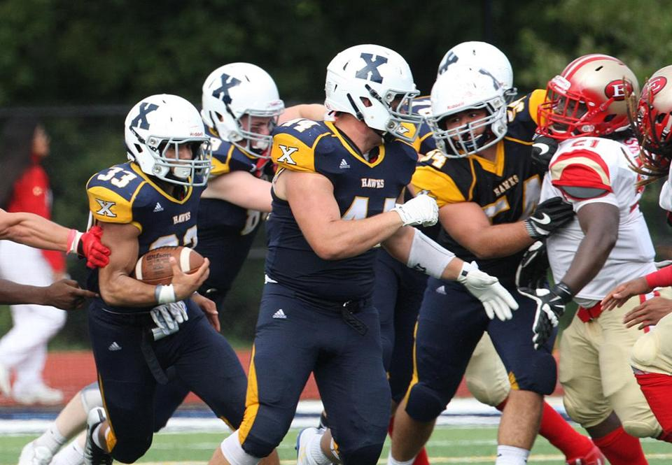 Westwood, MA 09/10/16 Everett and Xaverian high school football.....................(George Rizer for the Globe) for SPORTS XAVERIAN BACK #33 DEVON PICCININ BREAKS TWO ARM TACKLES AND FOLLOWS BLOCKING UP FRONT...