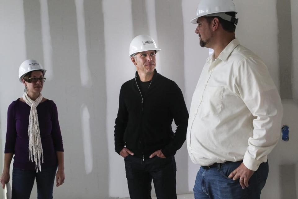 Nessan Bermingham (center), the CEO of Intellia Therapeutics, toured the company's new offices in Cambridge. The fast-growing startup plans to move in Dec. 1.
