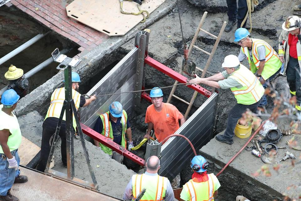 Boston 10/21/16 Boston Firefighters and emergency personal working to rescue construction workers trapped in a trench on Friday October 21, 2016. (Photo by Matthew J. Lee/Globe staff)