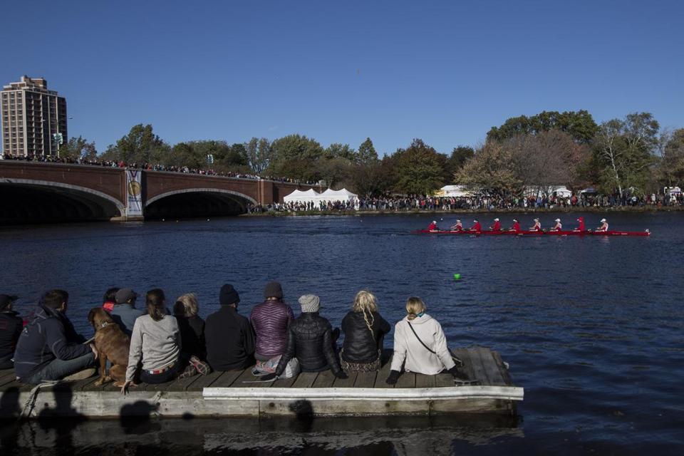 Cambridge, MA - 10/23/2016 - Spectators watch as a crew team rows under the Elliot Bridge during the Head of the Charles Regatta in Cambridge, MA, October 23, 2016. (Keith Bedford/Globe Staff)