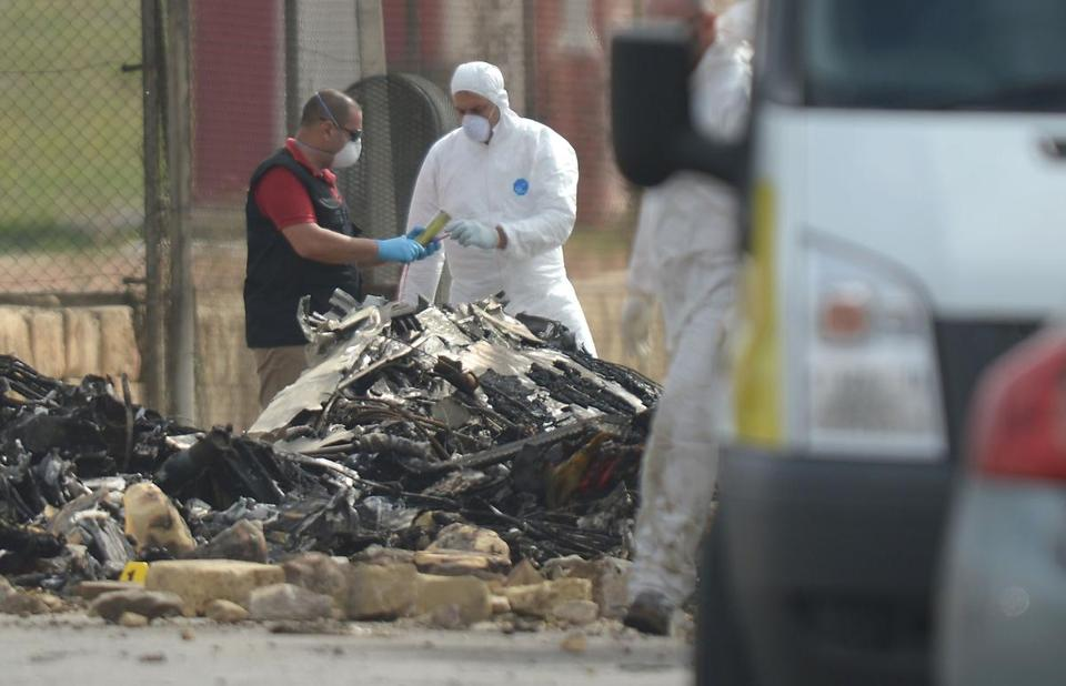 Forensics work on the site of a small plane crash at Malta International Airport, on October 24, 2016. Five French nationals died when a small plane crashed shortly after take off from Malta's international airport, the island's government said. The plane had been chartered by French customs and had been involved in the surveillance of people and drugs trafficking off Malta, the government said in a statement.Matthew Mirabelli/AFP/Getty Images