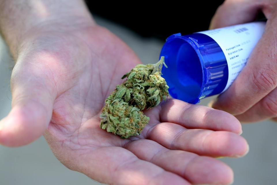 Salem Ma 6/24/2015 Chuck Grant (cq) displays his medical marijuana that he picked up from Massachusetts first medical marijuana dispensary in Salem. It is about 7 grams of marijuana that was in his bottle. He suffers from sleeplessnes and arthritis. Staff/Photographer Jonathan Wiggs Topic: Reporter