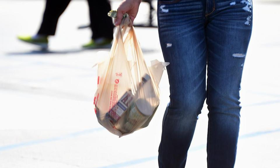 A woman carries her groceries in a plastic bag while leaving a supermarket in Monterey Park, California on September 30, 2014, where the state's Governor has signed the country's first statewide ban on single-use plastic bags from convenience and grocery stores. The ban, scheduled to take effect in July 2015, has led to a national coalition of plastic bag manufacturers immediately saying it will seek a voter referendum to repeal the law. AFP PHOTO / Frederic J. BROWNFREDERIC J. BROWN/AFP/Getty Images