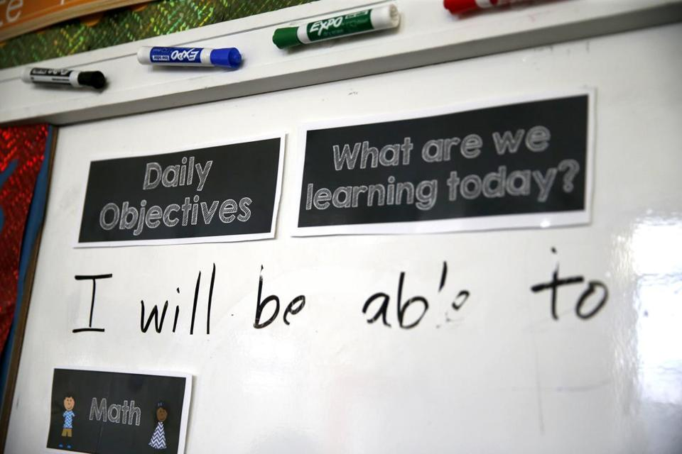 Daily objectives were listed on a whiteboard inside a classroom at Bridge Boston Charter School in Dorchester.