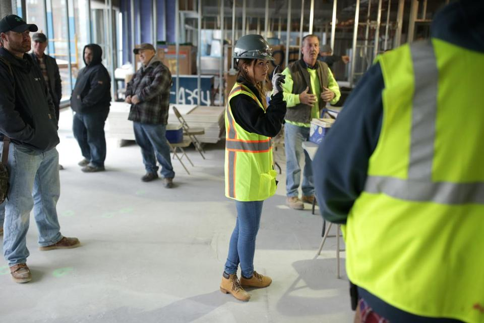 Cambridge Ma 10-27-2016 Danielle Weiler is a Assistant Project Manager at J.C. Cannistraro. She was on a job site on Binney Street in Cambridge. She was counting employees at the end of their shift during a safety huddle. Boston Globe Staff/Photographer Jonathan Wiggs