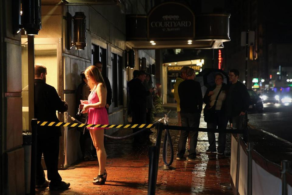 A doorman checked a woman's identification outside the Royale and Candibar nightclubs on Tremont Street.