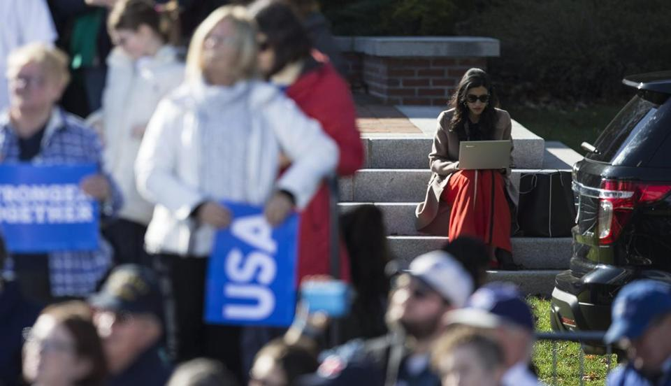 Huma Abedin (right) worked on her laptop during a Clinton rally last week in Manchester, N.H.