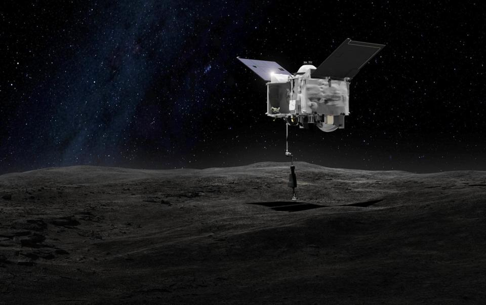 This artist's rendering made available by NASA on Tuesday, Sept. 6, 2016 shows the Origins Spectral Interpretation Resource Identification Security - Regolith Explorer (OSIRIS-REx) spacecraft contacting the asteroid Bennu with the Touch-And-Go Sample Arm Mechanism. The mission, planned for launch on Thursday, Sept. 8, 2016, aims to return a sample of Bennu's surface to Earth for study as well as return detailed information about the asteroid and its trajectory. (NASA/Goddard Space Flight Center via AP)