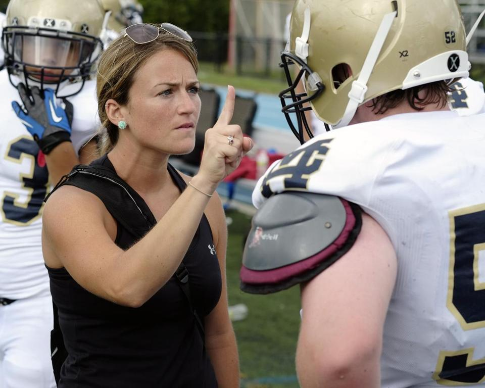 Malden Catholic athletic trainer Torey Manzi administers a concussion check during a Malden-Xaverian football game in 2012.