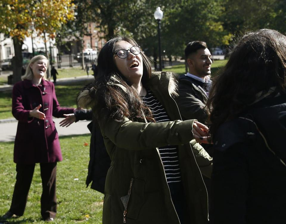 Boston, MA -- 11/1/2016 - Students take part in an exercise where they laughed as they introduce themselves as part of Suffolk University's Dr. Sushil Bhatia's laughter session to relieve stress on the Boston Common. (Jessica Rinaldi/Globe Staff) Topic: 02laughpic Reporter: