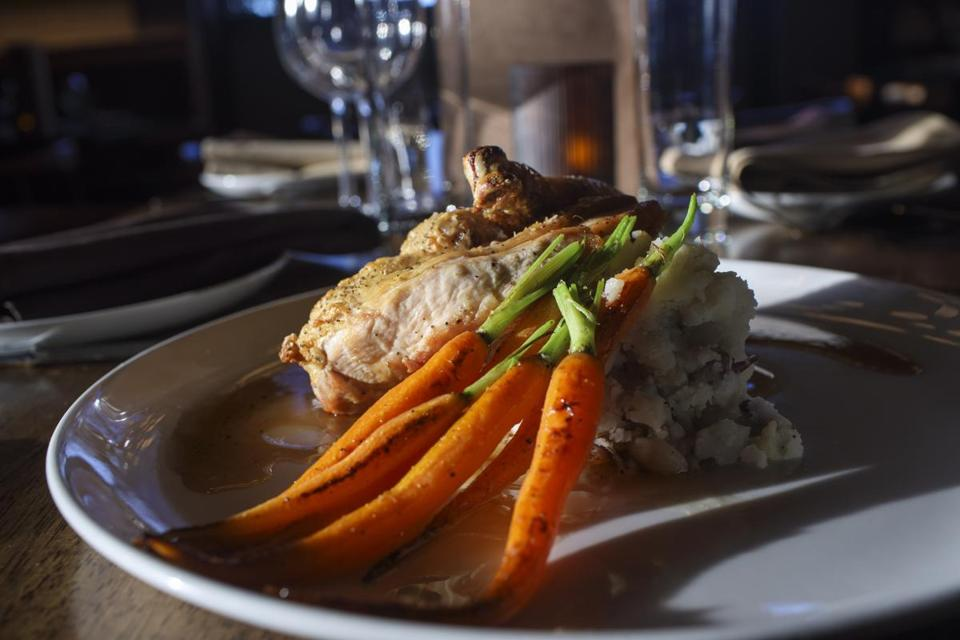 Chelsea, MA - 11/1/2016 - An order of maple thyme chicken with roasted carrots and potatoes sits on a table at the Chelsea Station Restaurant Bar and Lounge in Chelsea, MA, November 1, 2016. (Keith Bedford/Globe Staff) Topic: Reporter: Stephanie Schorow
