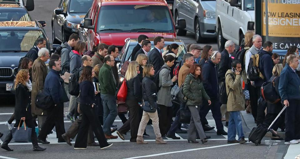 BOSTON, MA - 11/02/2016: THE MORNING RUSH HOUR in Boston at 9am crossing Atlantic Avenue and Summer Street from South Station in Boston. (David L Ryan/Globe Staff Photo) SECTION: METRO TOPIC stand alone photo