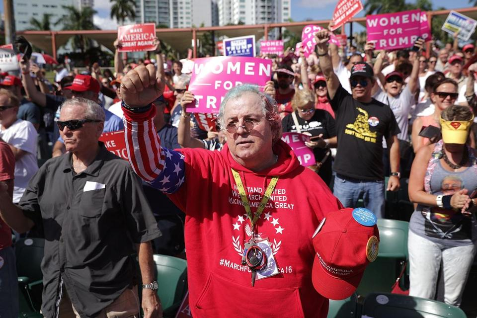 Supporters of Republican presidential nominee Donald Trump cheer during a campaign rally at Bayfront Park Amphitheater in Miami on Nov. 2.