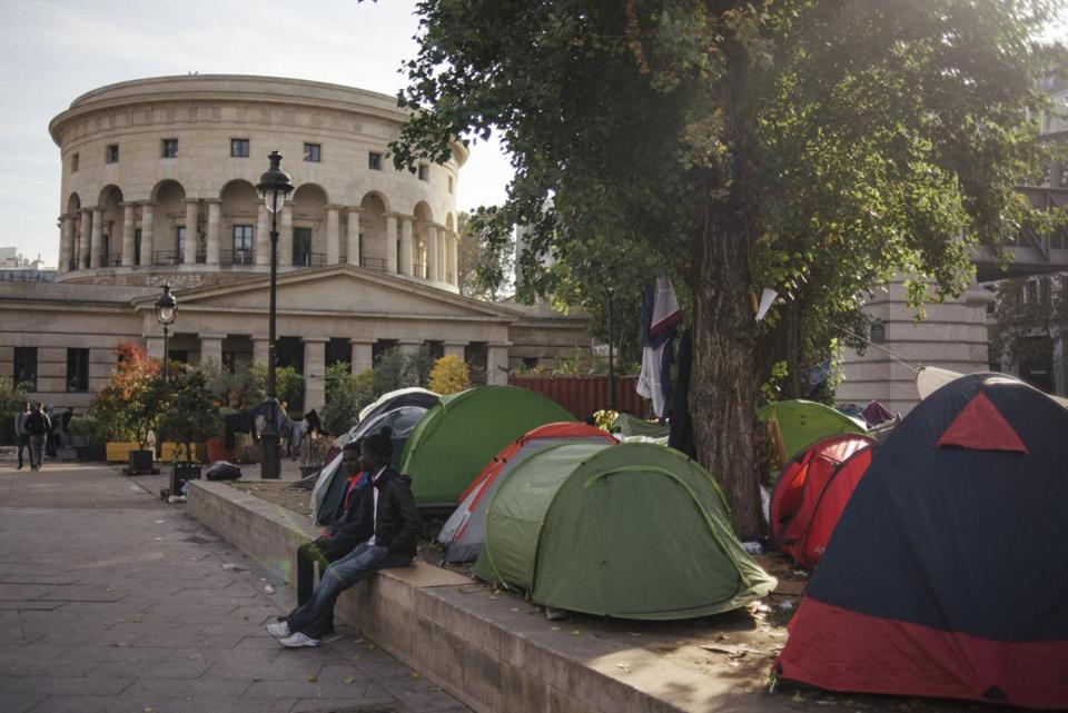As many as 100 migrants arrive in Paris a day, with most of them making their enclaves set up along the city's streets.