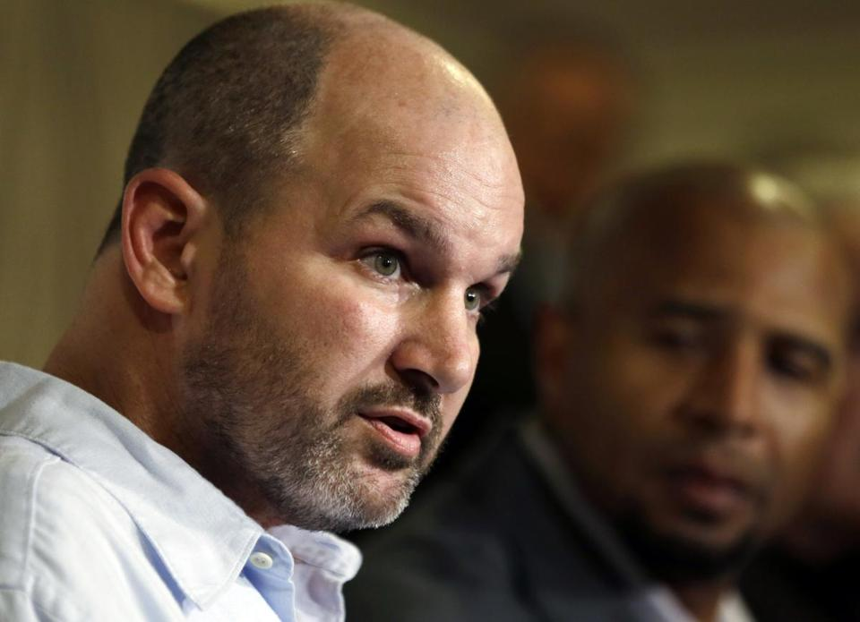 FILE - In this April 9, 2013 file photo, former NFL player Kevin Turner, left, speaks beside former player Dorsey Levens during a news conference in Philadelphia. Researchers in Boston announced Thursday, Nov. 3, 2016, that Turner, who died in March from complications of amyotrophic lateral sclerosis (ALS) at the age of 46, had the most advanced stage of Chronic Traumatic Encephalopathy (CTE) with motor neuron disease. (AP Photo/Matt Rourke, File)
