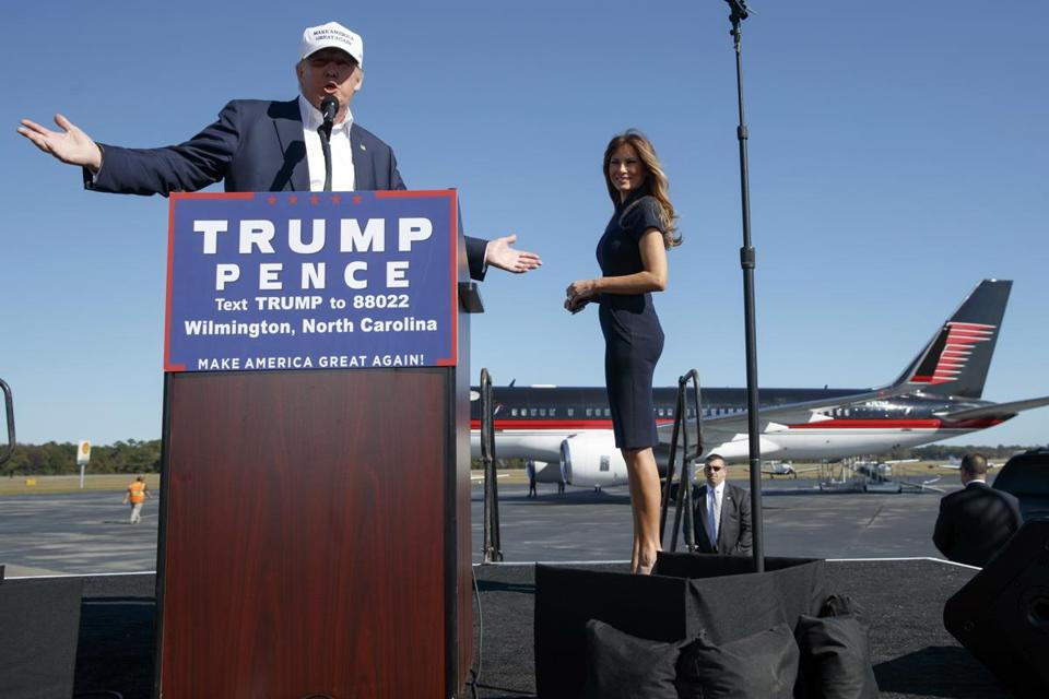Melania Trump (right) walked offstage as Donald Trump spoke Saturday during a campaign rally in Wilmington, N.C.