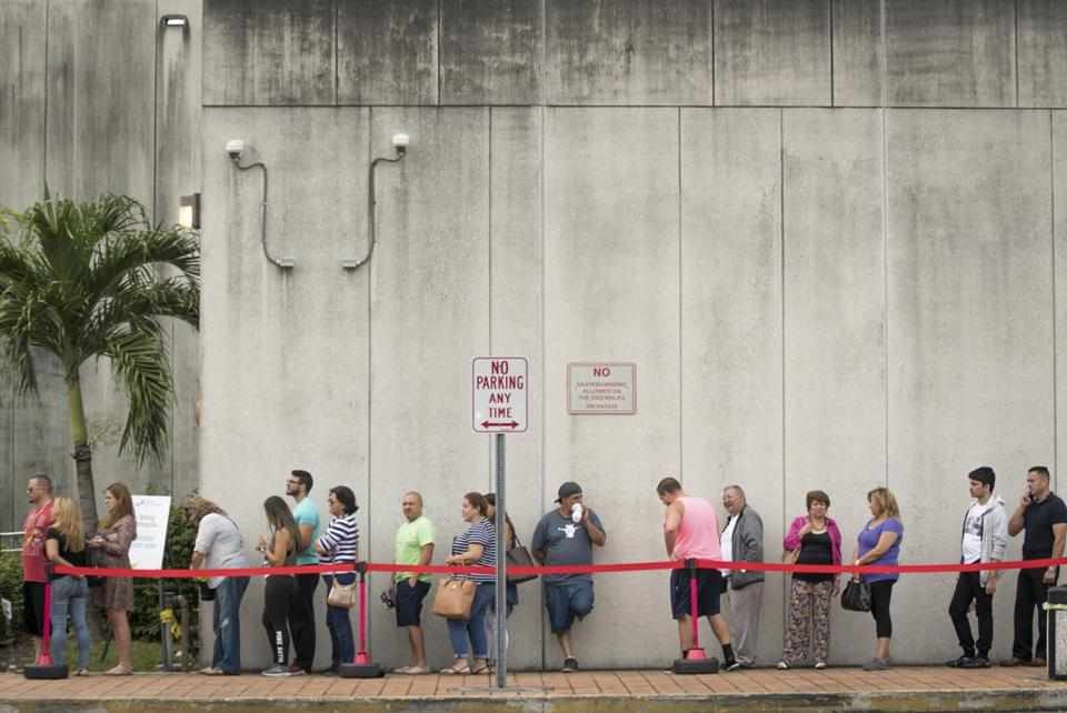 Early voters lined up outside the West Dade Regional Library in Miami on Monday.