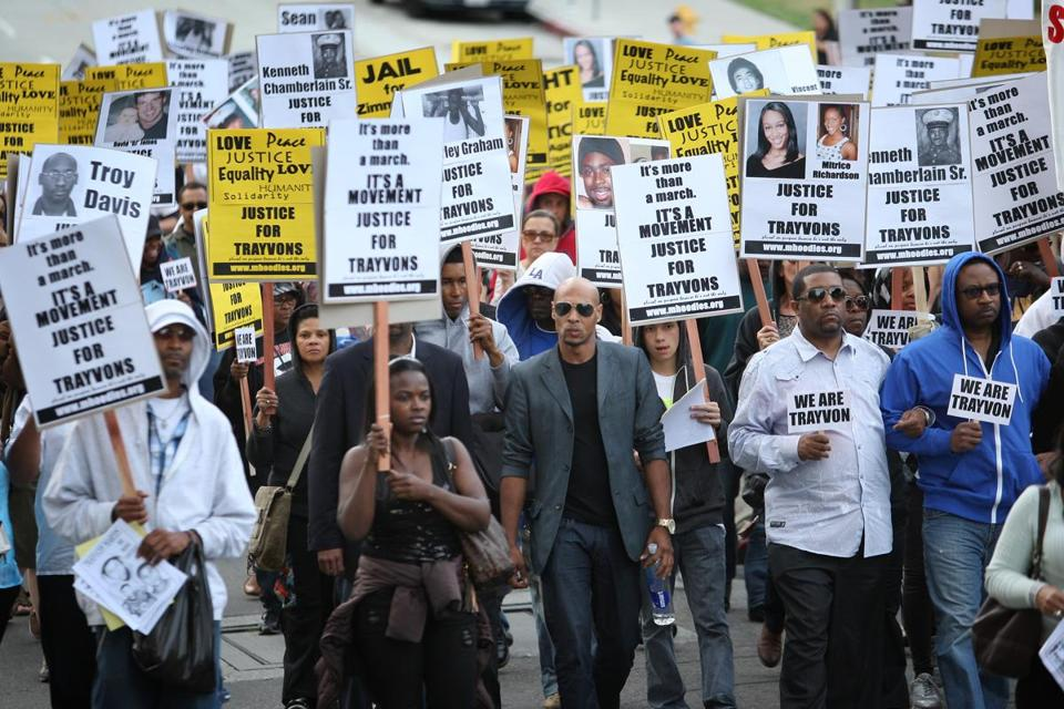 People walk in a silent protest march to demand justice for the shooting of Trayvon Martin, on April 9, 2012 in Los Angeles.
