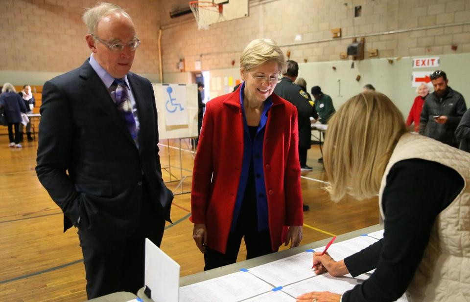 Elizabeth Warren and her husband, Bruce Mann, checked in to vote in Cambridge on Tuesday.