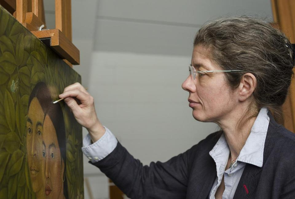 "Rhona MacBeth, an MFA conservator of paintings, works on Frida Kahlo's ""Dos Mujeres (Salvadora y Herminia)."""