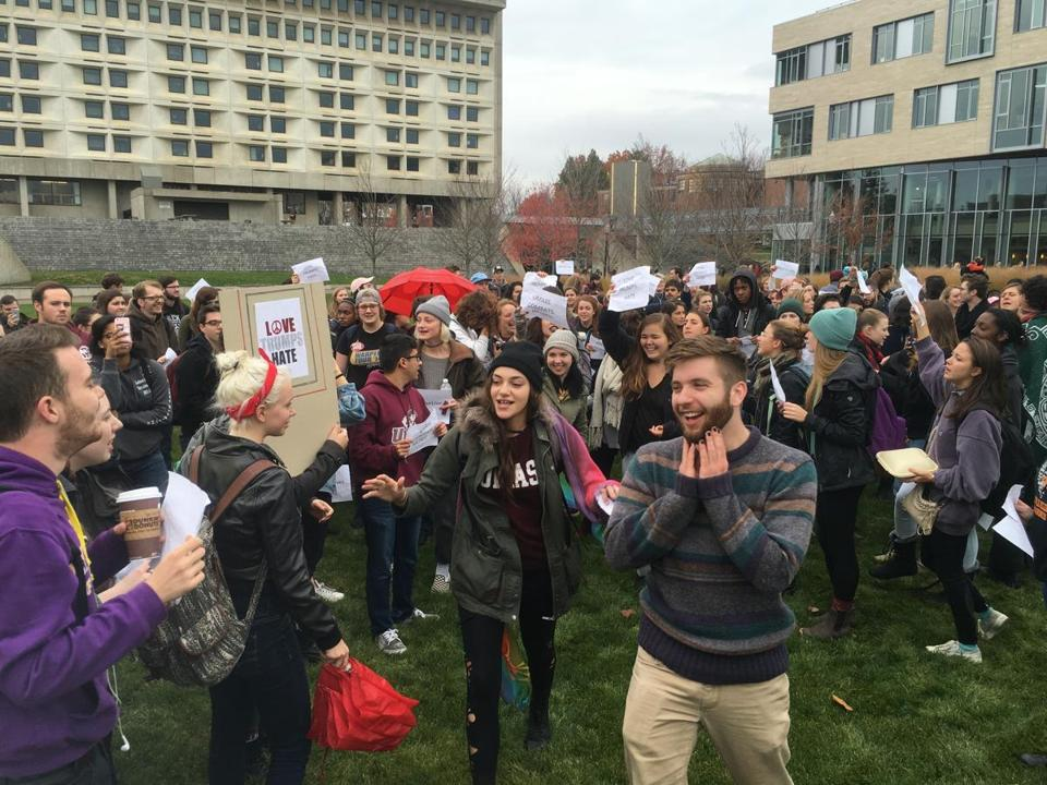 Organizer Kyle Hartmann, a senior theater major, stands among some 100 protesters at UMass Amherst on Wednesday afternoon.