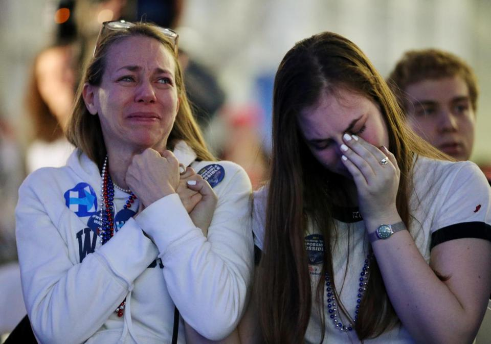 Wendy Salz and her daughter, Wellesley College senior Moira Johnston, wept while watching the results Tuesday at the college's Dorothy Town Field House. Salz also attended Wellesley.