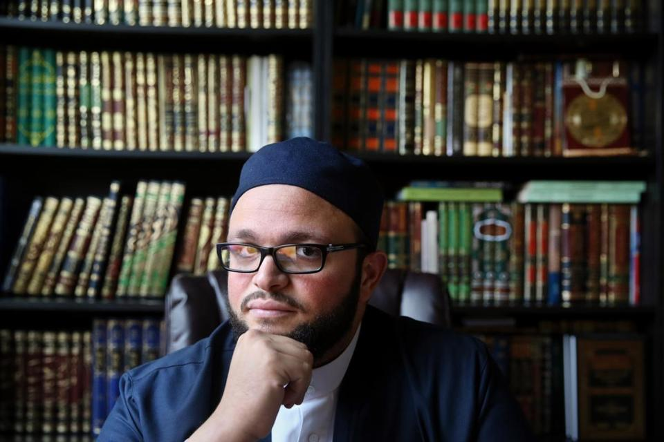 Shaykh Yasir Fahmy posed for a portrait in his office at the Islamic Society of Boston Cultural Center.