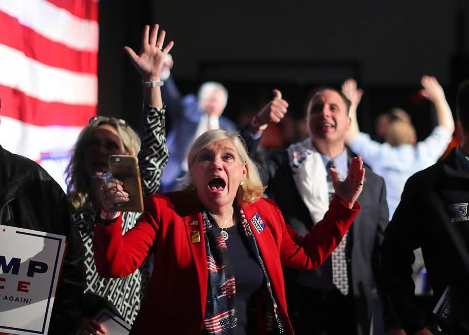 Braintree-11/08/2016- Trump supporter Virginia Greiman cheers as Wisconsin goes to Trump as she watched the election results on a giant tv at an election night party for Donald Trump held at the F1 indoor car racetrack ballroom. John Tlumacki/Globe Staff (metro)