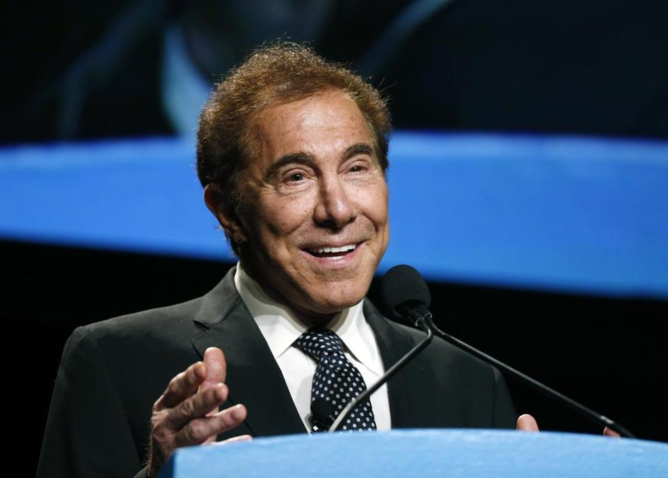 FILE - In this Jan. 15, 2015, file photo, Steve Wynn, CEO of Wynn Resorts, delivers the keynote address at Colliers International Annual Seminar at the Boston Convention Center in Boston. From a pair of giant golden dragons on the edge of a vast man-made lagoon to phoenix and cloud motifs throughout the interior, Wynn's new multibillion dollar Macau resort brims with auspicious Chinese symbolism. The U.S. casino mogul will be hoping luck is on his side as he prepares to launch his Wynn Palace project in the Asian gambling hub, where growth is downshifting into a new phase after years of turbocharged expansion. (AP Photo/Elise Amendola, File)