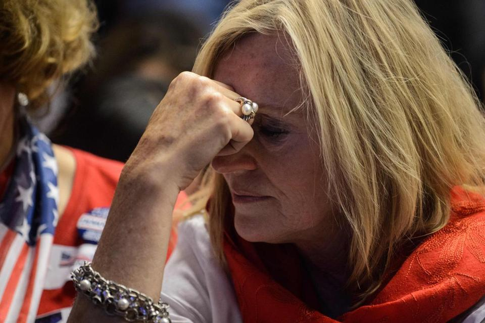 A supporter of Hillary Clinton reacts as she watches live coverage of the US elections at an event organised by the American Chamber of Commerce in Hong Kong on November 9, 2016. Share markets collapsed and the dollar tumbled against the yen and the euro as Donald Trump looked on course to win the race for the White House, in a stunning upset with major implications for the world economy. / AFP PHOTO / ANTHONY WALLACEANTHONY WALLACE/AFP/Getty Images