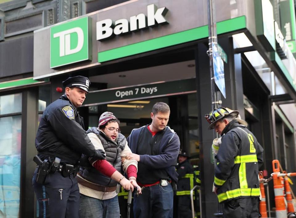 One of the protestors who blocked the entrance of a TD Bank on Winter Street was arrested.
