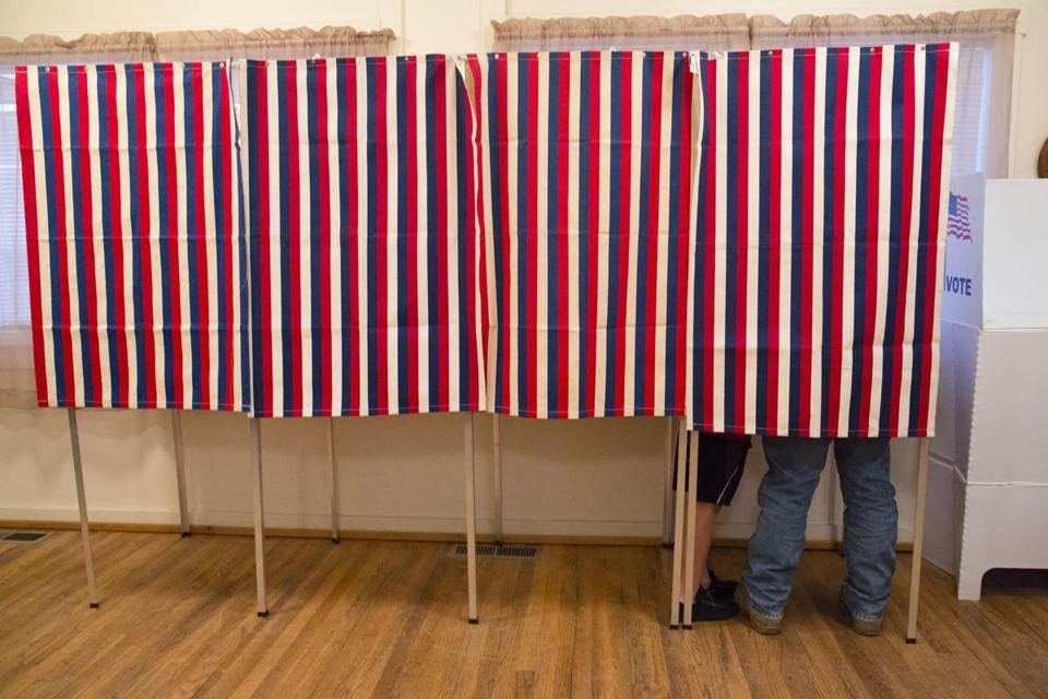 In this Nov. 8, 2016, photo, a voter fills out his ballot at the Wilson School House in unincorporated Wilson, Idaho. Donald Trump's victory came as a surprise to many Americans, the nation's pollsters most of all. Heading into Election Day, most national surveys overstated what will likely be a narrow popular vote advantage for Hillary Clinton and led many to believe she was a shoo-in to win the Electoral College. (AP Photo/Otto Kitsinger)