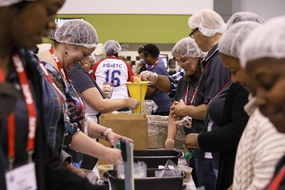Attendees of the Georgia Education Technology Conference packaged meals for Atlanta food banks at the Georgia International Convention Center in Atlanta earlier this month.