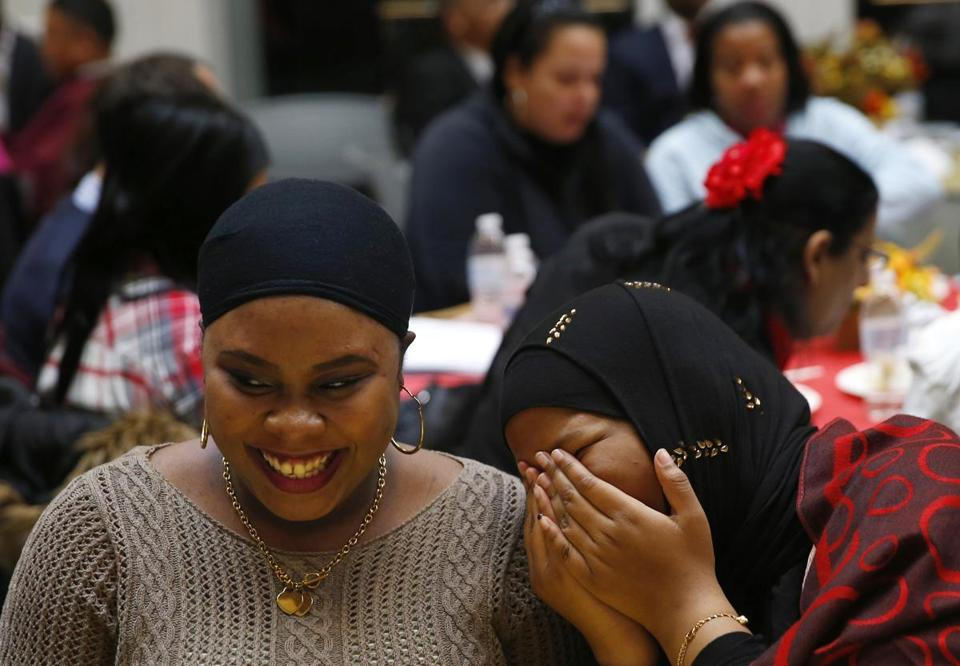 Jawaher Noor (right), of Quincy, laughed with Nechka Mars, of Hyde Park, shared a laugh at the luncheon. Noor is originally from Somalia and Mars from Haiti.
