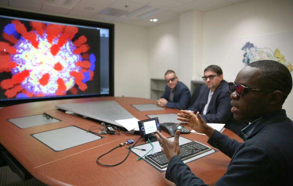 Sanofi Pasteur's Eliud Oloo discussed research on improving flu vaccines at the firm's Cambridge lab.