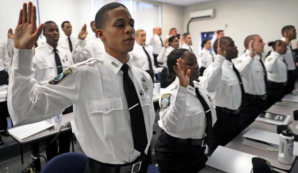 BOSTON, MA - 11/16/2016: Cadet Jose Correia ( far left ) with other cadets takes the oath at the Boston Police Academy where Mayor Martin J. Walsh and Boston Police Commissioner William B. Evans attended a swearing in of Boston Police Cadets to the Boston Police Department. (David L Ryan/Globe Staff Photo) SECTION: METRO TOPIC 17cadet