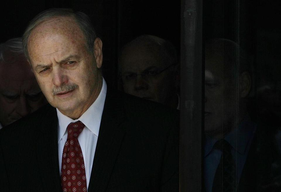 FILE - In this June 15, 2011, file photo, former Massachusetts House Speaker Salvatore DiMasi walks out of the Federal courthouse in Boston. DiMasi's bid to win early release from prison is moving to a federal courtroom. DiMasi has been battling cancer while serving nearly five years of an eight-year prison sentence for corruption. (AP Photo/Stephan Savoia, File)