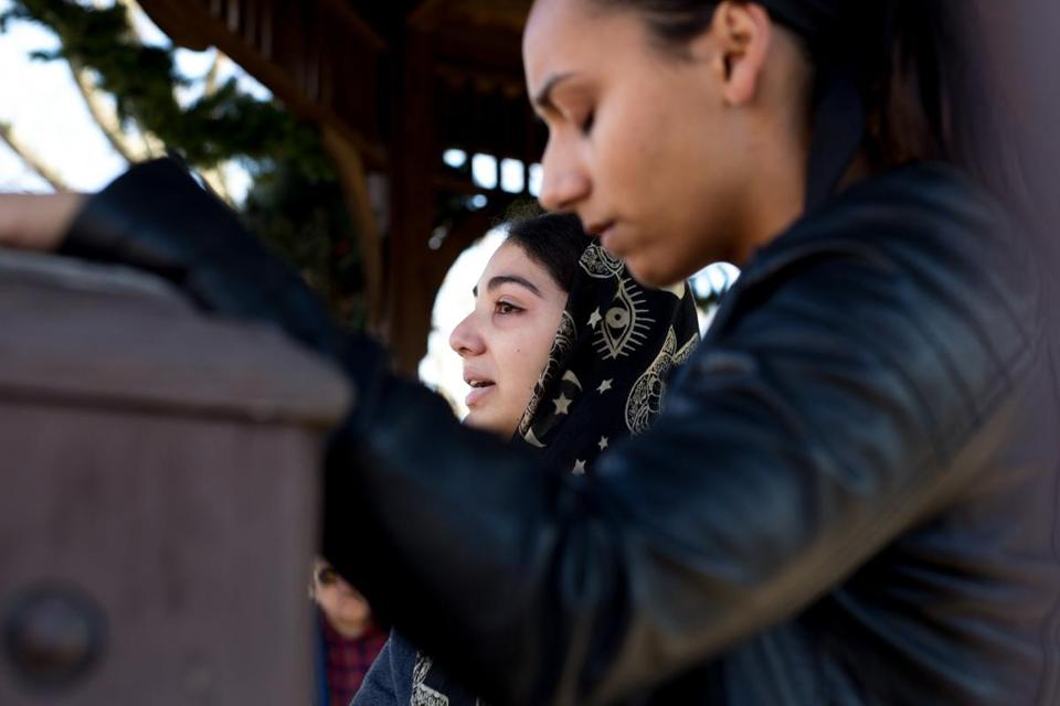 In 2016, Natick High School students Titi Scorzailo, left, and Bela Ghosh spoke at a rally for peace and solidarity in Natick. The rally came after hate crimes in the town.