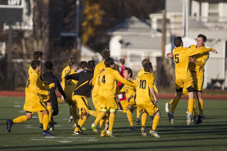 Nauset Varsity Soccer celebrates after winning the MIAA Division II Soccer championship against Masconomet in Lynn on Saturday, November 19, 2016. (Scott Eisen for The Boston Globe)
