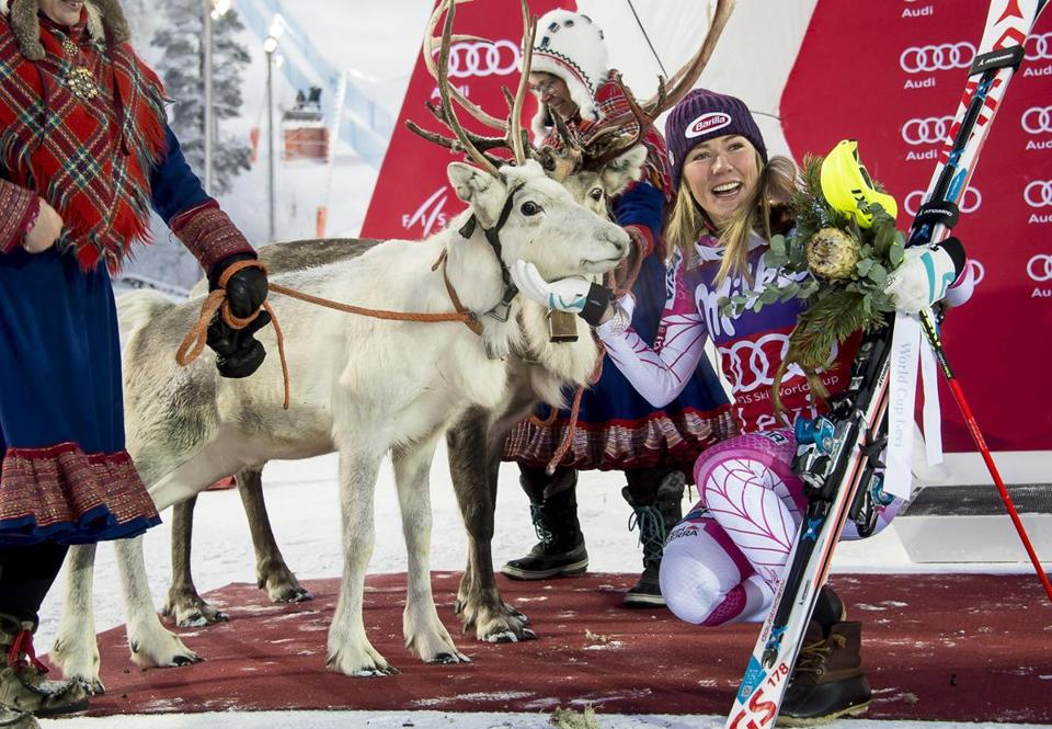 Mikaela Shiffrin with Sven the reindeer, part of her prize for winning a World Cup slalom race in Finland this month.